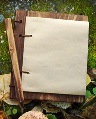 Blank paper notepad with wooden cover