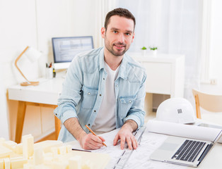 Young attractive architect working at the office