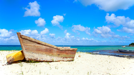 Small wooden boat on the beach