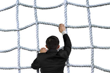 Businessman climbing crisscross rope net isolated on white