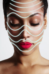 woman with a laser face mask, lined like a massage lines