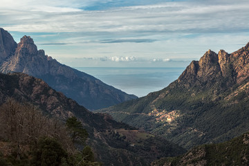 Ota in Corsica with mountains and Mediterranean sea