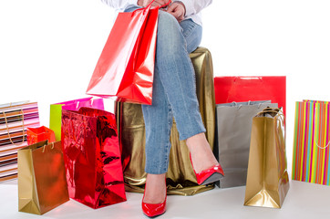 Woman sitting in the middle of shopping bags