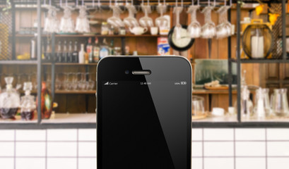 close up smart phone against beautiful  kitchen background