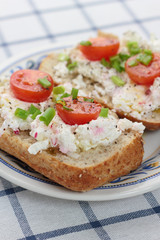 Cottage cheese with radish, chives and cherry tomatoes.