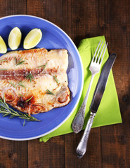 Dish of Pangasius fillet with rosemary and lime