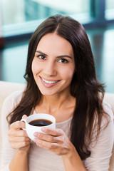 Enjoying her coffee break.