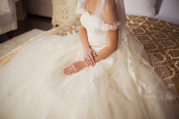 Beautiful bride sits on bed