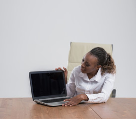 Good news on the display - Female executive with laptop