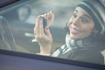 Excited woman looking at her mobile phone