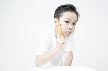 A boy early practice shaving on white