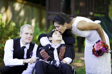 Biracial bride kissing her little brother on her wedding day. Ch