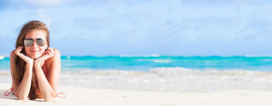 long haired girl in bikini on tropical caribbean beach