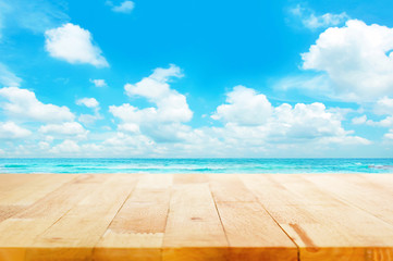 Wood table top on blue sea & sky background