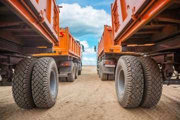 view through two rows of tippers close up