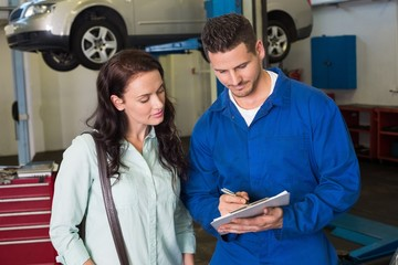 Mechanic and customer talking together