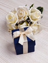 white flowers and blue gift box