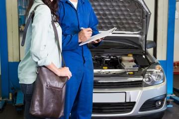 Customer listening to his mechanic