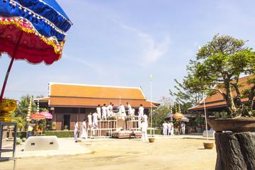 Buddhist in white cloth making buddha image