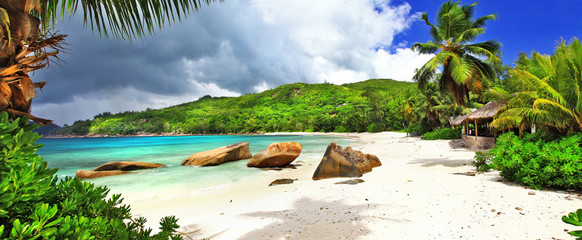 Fototapete - tropical holidays in Seychelles , panoramic view of Takamaka bea