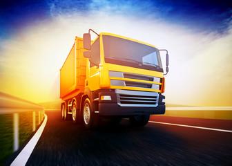 orange semi-truck on blurry asphalt road under blue sky and suns