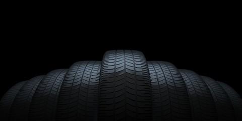Car tires on black background