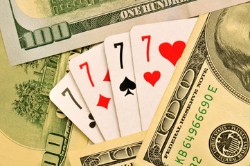 Playing cards and dollars