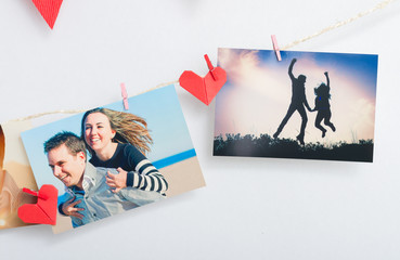 Photos of a couple hanging on clothesline with origami