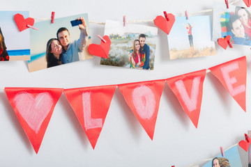 Photos hanging on clothesline