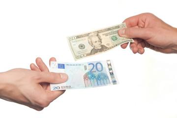 hands exchanging euros and dollars money, money exchange concept