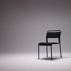 chair with blank space and dramatic light