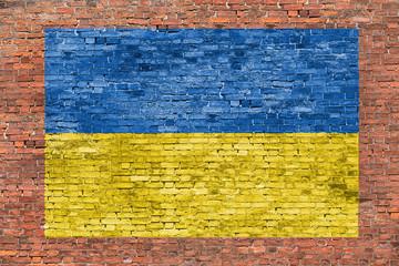 Flag of Ukraine painted over brick wall
