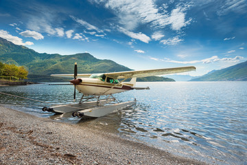 Float plane moored at a beach on Lake Como in Italy, Europe