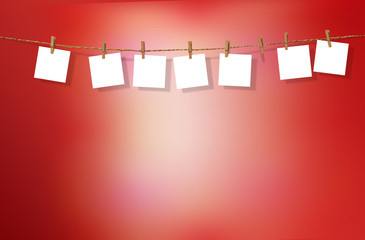 Clothesline with white notes on red background