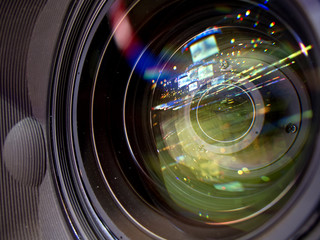 reflection and glare in the lens of the television camera.