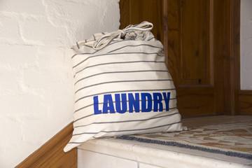 Laundry bag outside a door