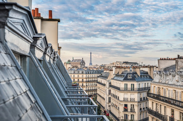 Fotobehang Parijs Roofs of Paris with Eiffel Tower in background