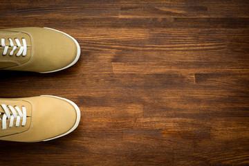 Trevelaing sneakers on wooden background