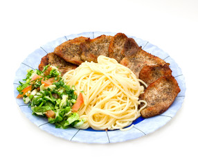Spaghetti with fried pork fillet and fresh vegetables salad