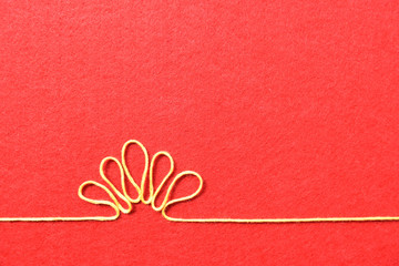 Valentines day card - flower made from wire on red background