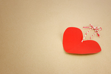 Red heart on brown as valentines background