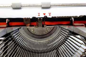 written typewriter I Love You with red ink