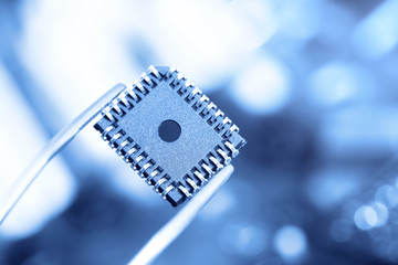 computer chip with tweezers, electronic