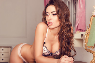 Young beautiful woman in lingerie: lace white dark blue bra, pan