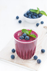 blueberry milkshake with mint and chocolate on a table