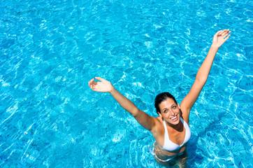 Joyful woman having fun in swimming pool