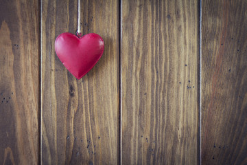 Valentine's day. A red heart hanging on a clothesline.