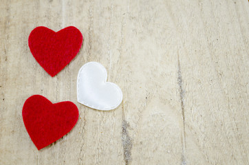 Three hearts on a wooden board
