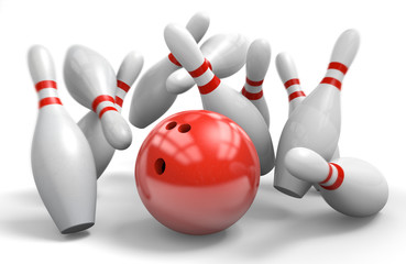 Red bowling ball knocking over pins in a perfect strike