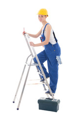 young woman builder in blue coveralls with toolbox, screwdriver